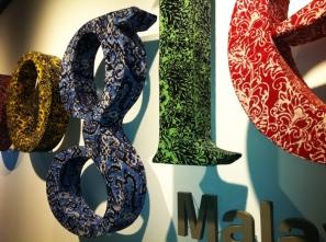 signage wrapped in batik